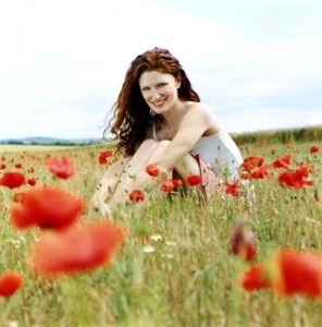 red head in flowers